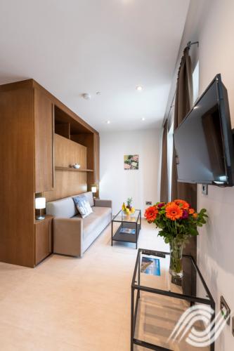 Deluxe Studio Living And Bed Area Westone